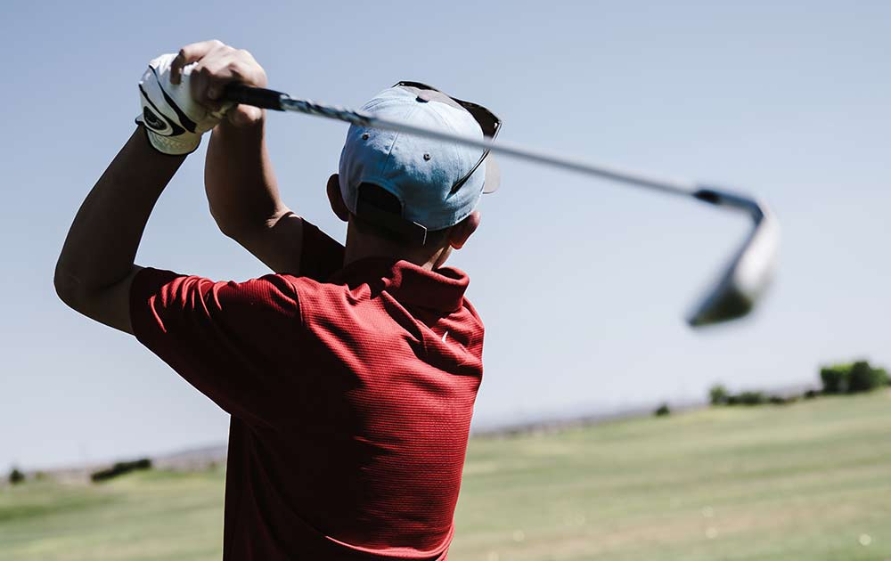 Golfspieler nach Abschlag